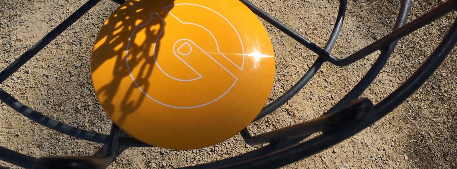 Glide-branded disc stamp in basket