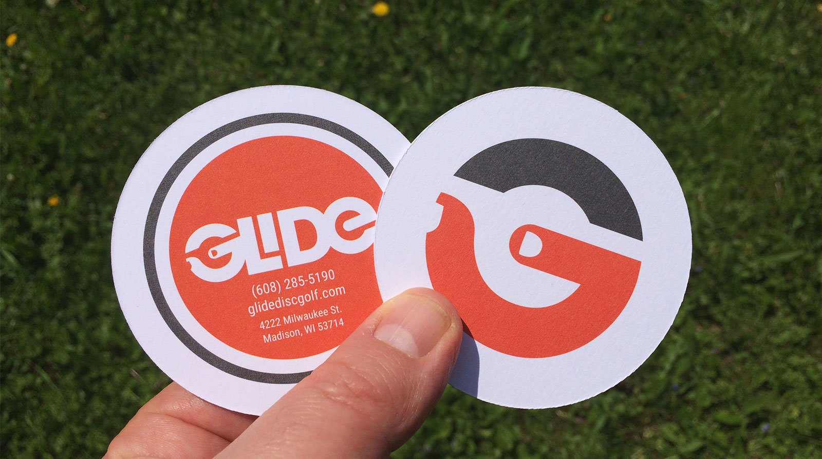 thick, circle business cards for Glide Disc Golf, designed by Phonographik Design Studio