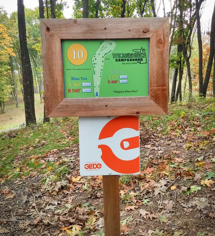 Glide identity on tee sign at Wilderness disc golf course, Montello, WI